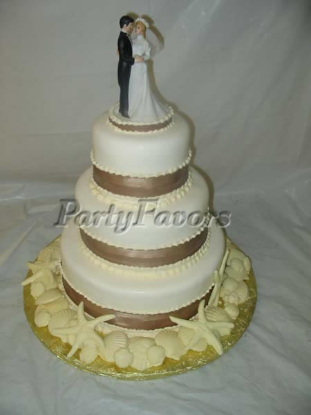 wedding cake with bride and groom toppers